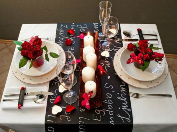 small-but-romantic-valentines-day-table-settings-with-candles-in-center-and-flower-above-the-plate