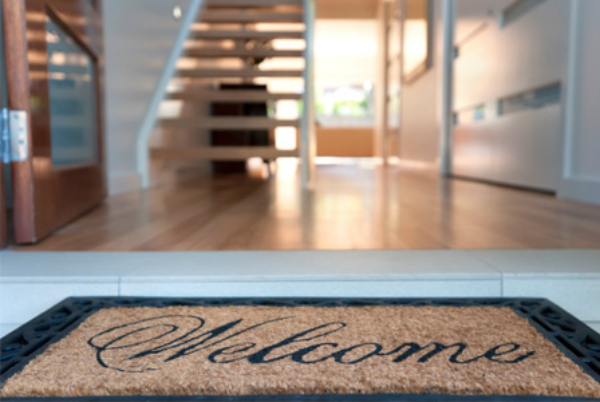 welcome-mat-in-front-of-house
